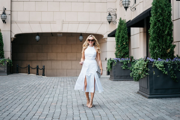 Jessica Sturdy of Bows & Sequins, lifestyle and travel blog, wears a white Fame and Partners dress, heels and Celine sunglasses.