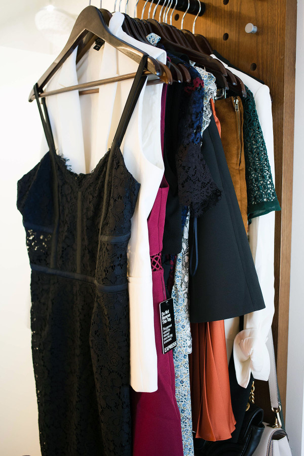 Jessica Sturdy of fashion blog Bows & Sequins displays special occasion outfit items, such as a little black dress, while she gets ready in New York City.