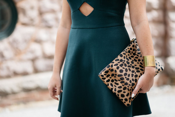 Bows & Sequins, a fashion blog, wearing a green Rachel Zoe dress with a cutout and leopard clutch in Chicago.