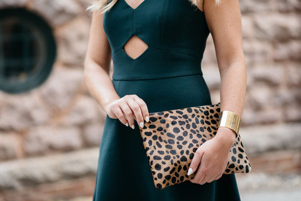 Jessica Sturdy of Bows & Sequins styling a J. Crew leopard clutch with a green dress in Chicago.