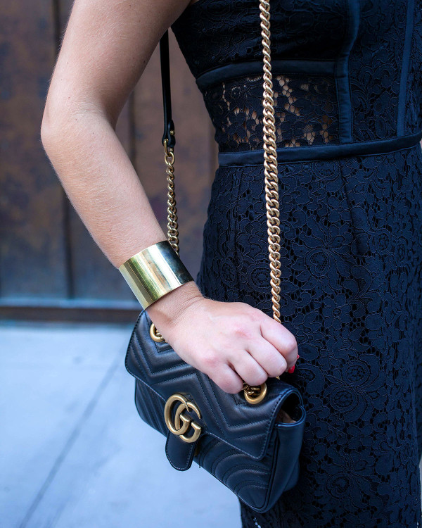 Jessica Sturdy of fashion blog Bows & Sequins styling a Gucci purse and bangle bracelet with a little black dress in NYC.