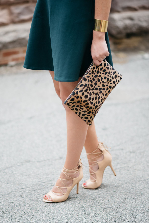 Bows & Sequins, a fashion-focused lifestyle blog, wearing a green Rachel Zoe dress, J. Crew leopard clutch purse, and heels.