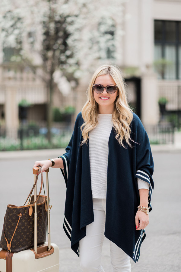 Bows & Sequins wearing a white and navy striped Tommy Hilfiger wrap sweater... Perfect for traveling!