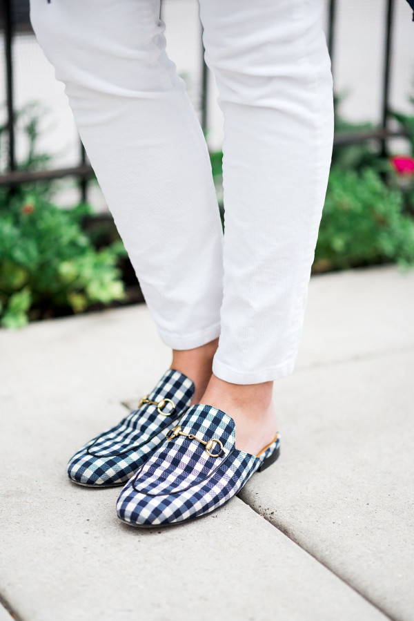 Bows & Sequins wearing a pair of Gucci gingham slip-on loafers in navy and white.