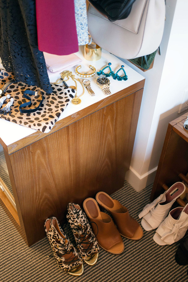 Jessica Sturdy of fashion blog Bows & Sequins organizes accessories, including shoes, jewelry, and a purse, to prepare for a special occasion in New York City.