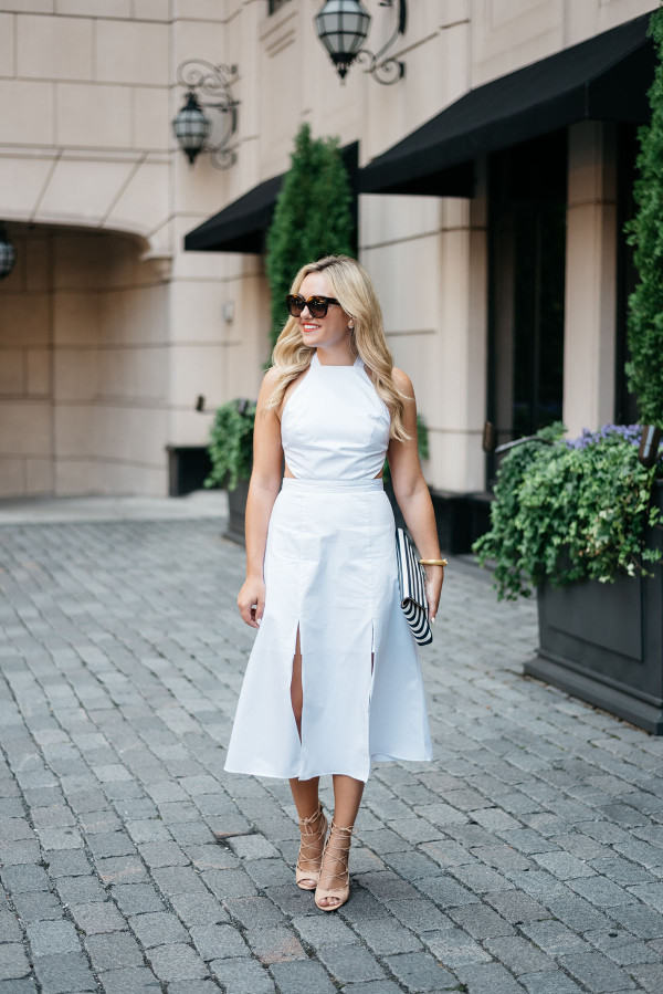 Jessica Sturdy for Bows & Sequins wears a white Fame and Partners dress with Celine sunglasses in Chicago.