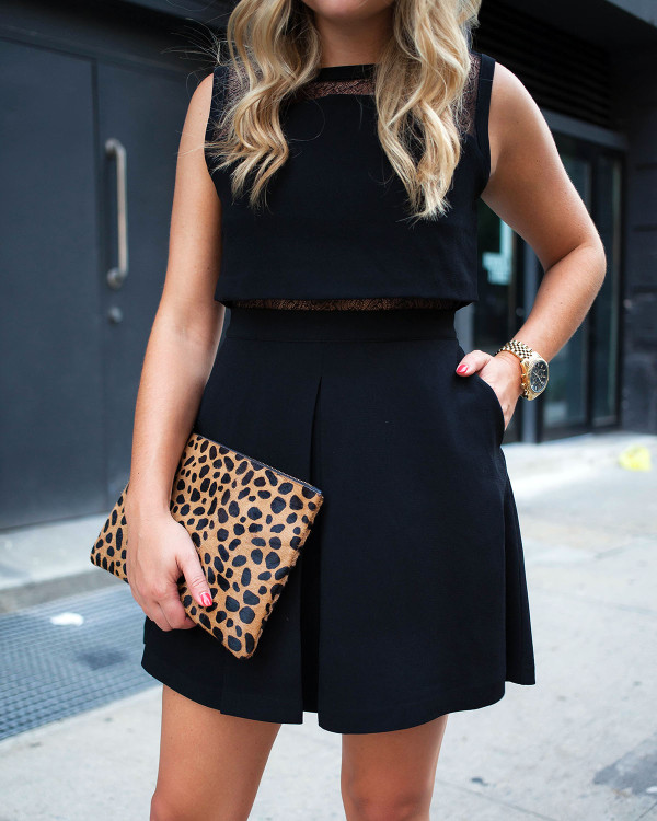Bows & Sequins wearing a two-piece black dress with lace details. Styled with a Clare V leopard calf hair clutch!
