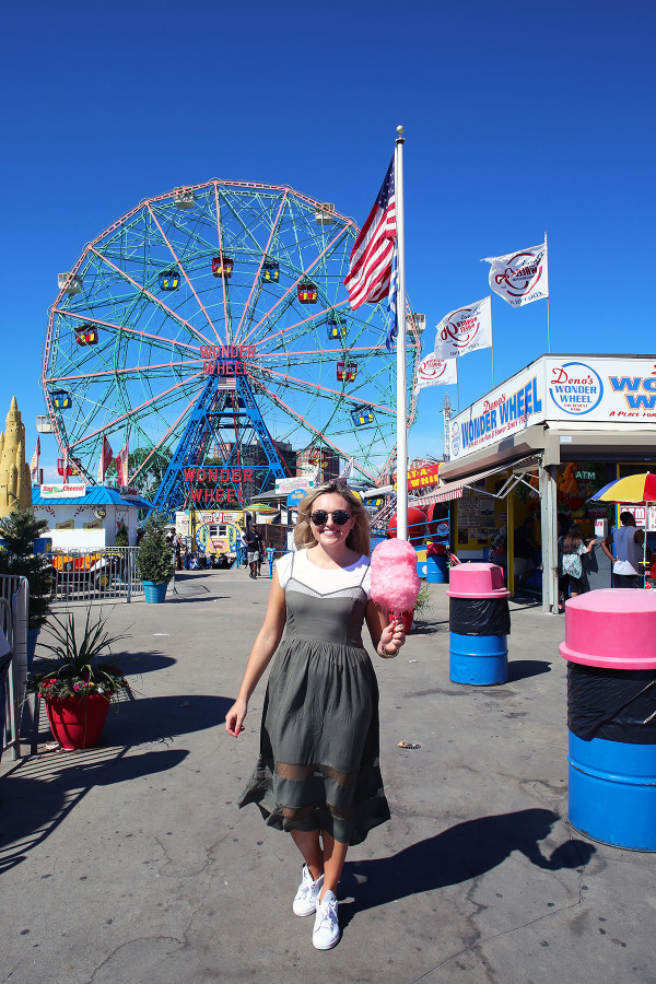 Bows & Sequins styling a white J.Crew tee shirt under an Azalea cami-strap dress with a Gucci crossbody bag, Illesteva sunglasses, and Stan Smith Sneakers in Coney Island NYC