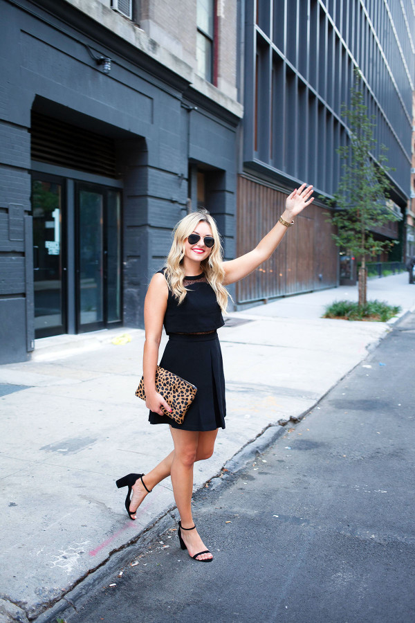 Fashion blogger Bows & Sequins wearing a little black dress, ankle strap sandals, gold aviator sunglasses, and a leopard clutch in New York City.