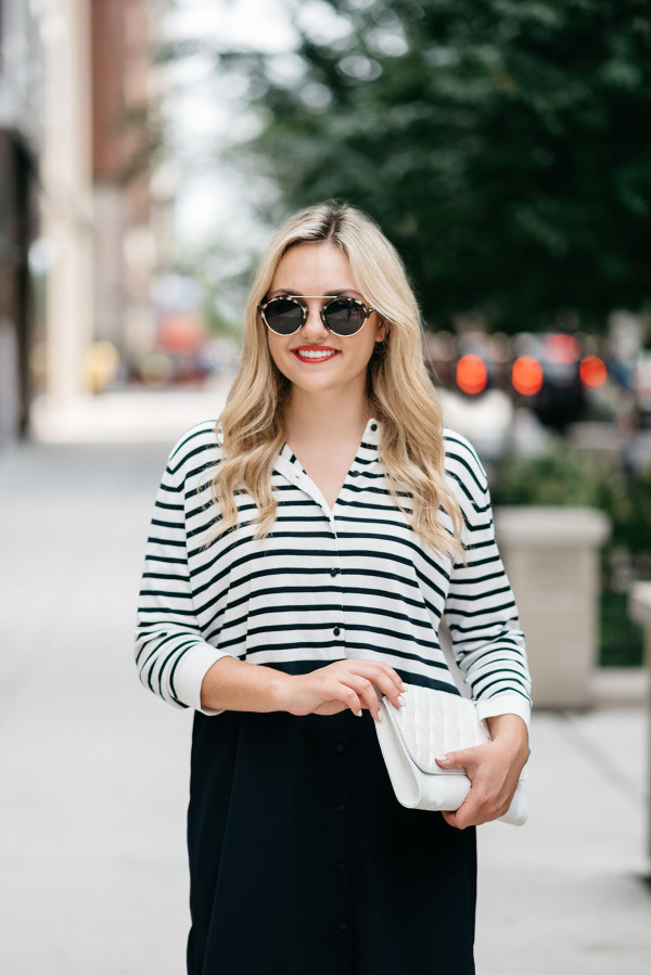 Fashion blogger Bows & Sequins styles a cute t-shirt dress, white purse, and sunglasses in Chicago's Gold Coast.