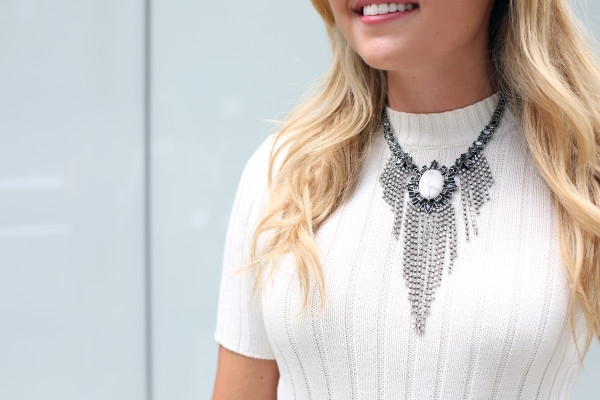 Bows & Sequins wearing a white howlite statement necklace from Express.