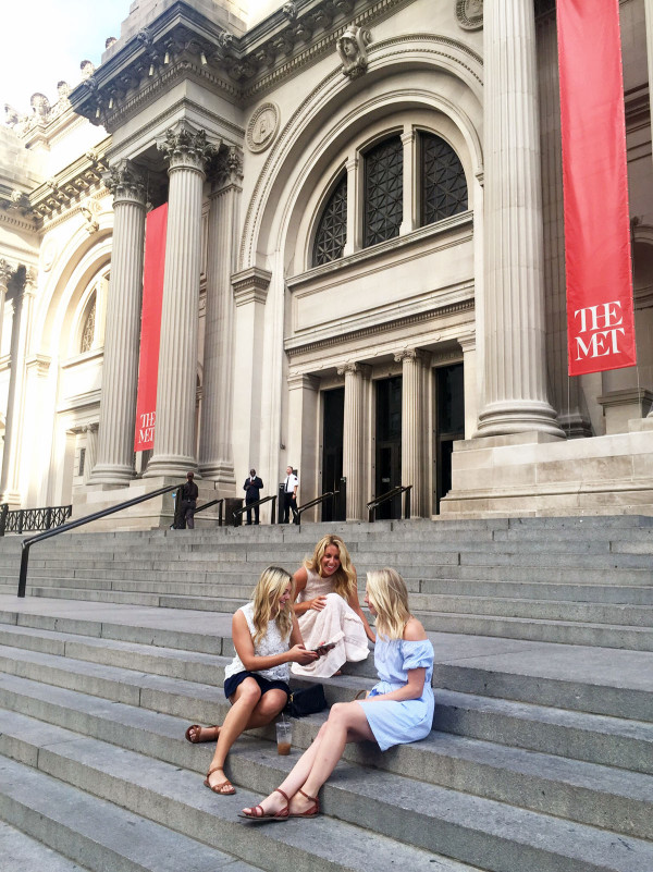 Girls on the steps of the Met Museum on Manhattan's Upper East Side in New York City like Gossip Girl