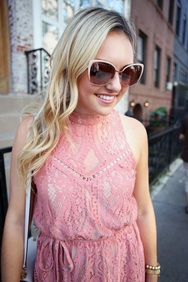 Fashion blogger Bows & Sequins wearing a Wayf pink lace dress with blush pink sunglasses. Makeup is Mary Kay!