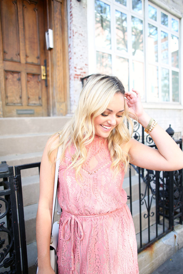 Blogger Bows & Sequins wearing a pink lace dress during NYFW paired with a glammed up everyday beauty look from Mary Kay!