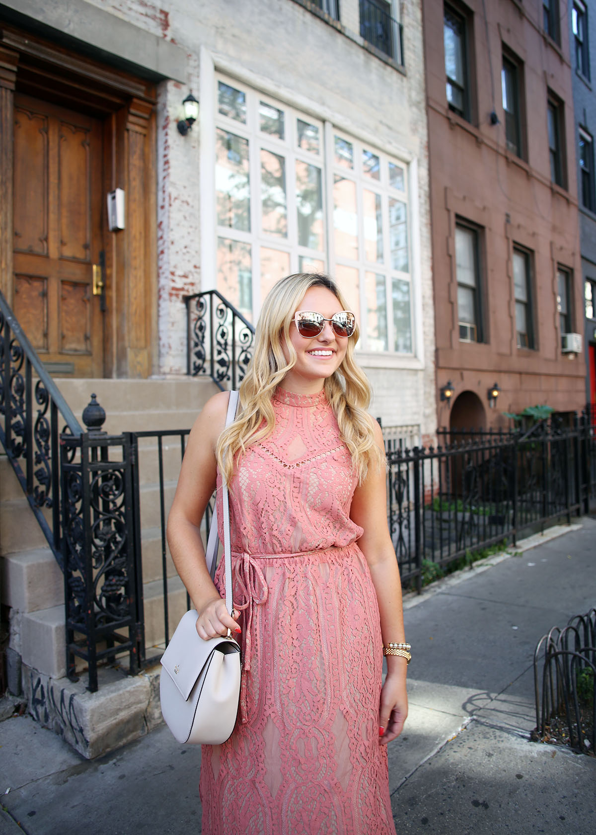 ff3a28782ba8 Fashion blogger Bows & Sequins wearing a pink lace midi dress during New  York Fashion Week