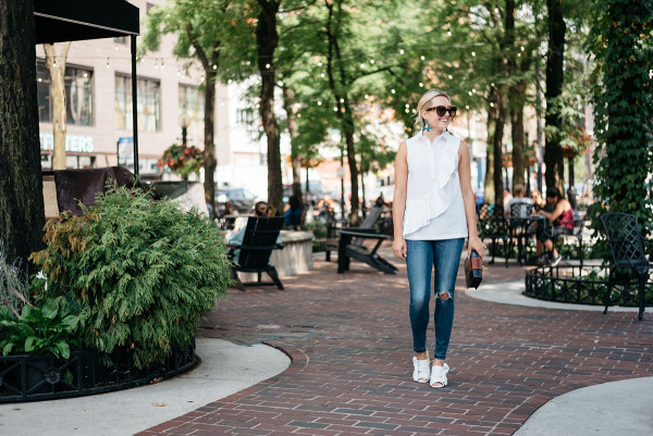 Bows & Sequins, Chicago fashion blogger, wearing a Topshop sleeveless ruffled shirt, ripped jeans from Old Navy, and white leather slides.