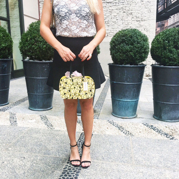 Bows & Sequins carrying a fashionable gift bag from the Lela Rose x Papyrus Collaboration.