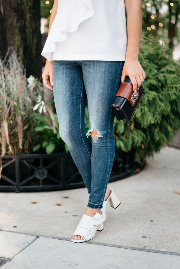 Fashion blogger bows & Sequins styling a pair of white Topshop leather mules with a bow.
