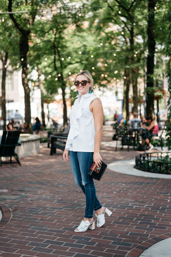 Fashion blogger Bows & Sequins wearing a Topshop ruffled shirt, Old Navy ripped jeans, Topshop leather bow mules, and Celine sunglasses in Chicago's Gold Coast.