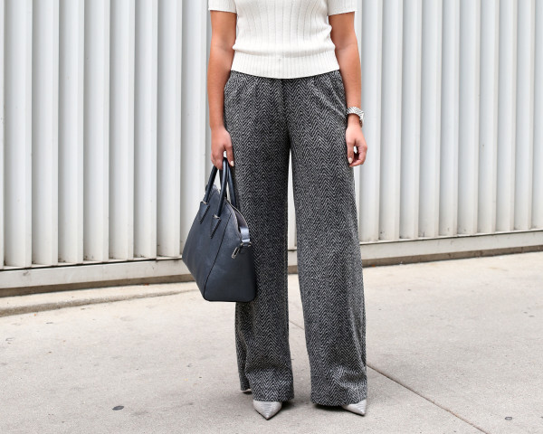 Bows & Sequins styling a pair of wool wide-leg pants for work! She paired them with a cream colored sweater, grey pointed toe pumps, and a sleek metallic tote.
