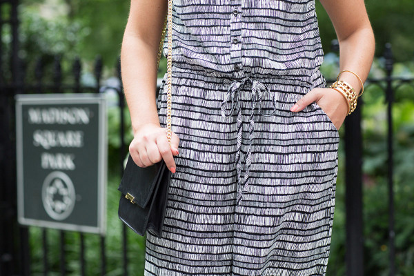 Bows & Sequins wearing a black & white jumpsuit in New York City.