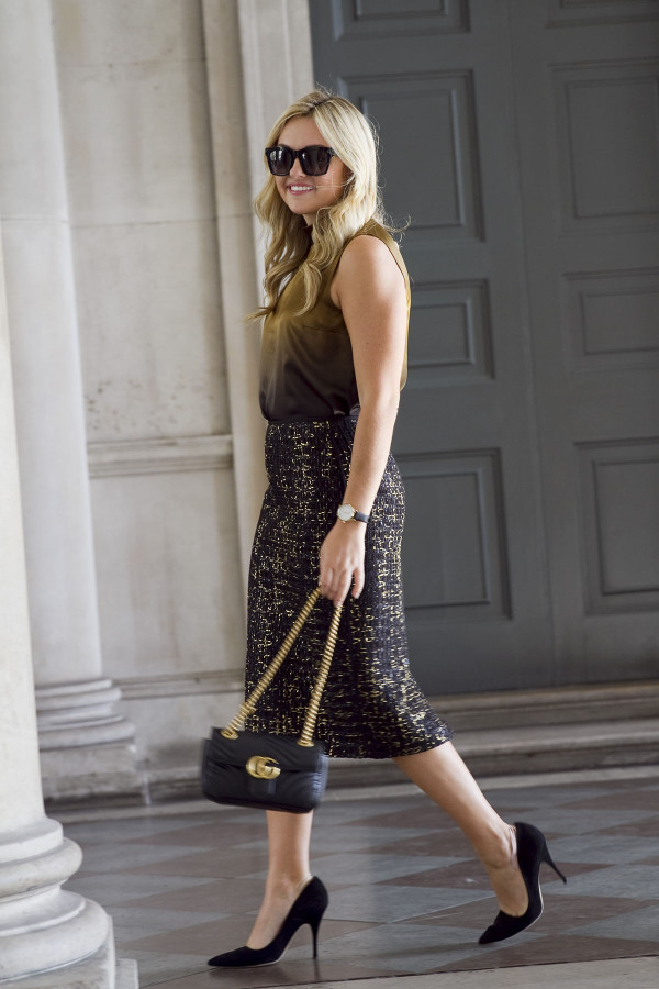 Bows & Sequins wearing a black and gold outfit in London during LFW