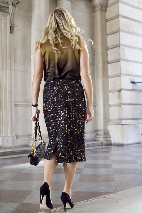 Bows & Sequins wearing a dressy black and gold outfit during London Fashion Week.
