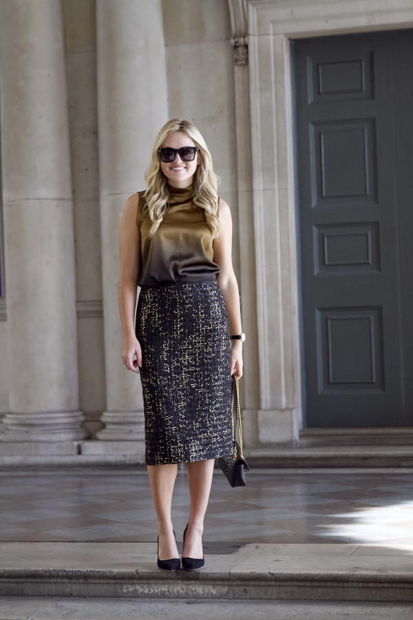 Bows & Sequins styling a dressy black and gold outfit. Lafayette 148 silk blouse and tweed skirt, Kate Spade pumps, a Gucci bag, and Valentino sunglasses.