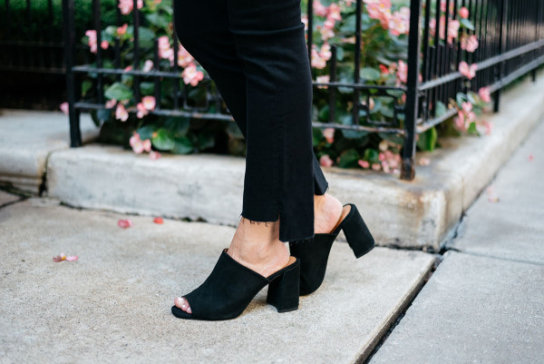 Bows & Sequins wearing black Frame denim with a frayed hem and Topshop suede mules.