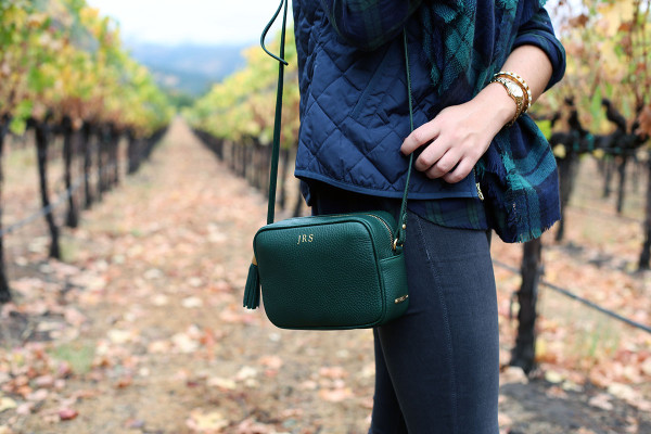 Bows & Sequins wearing a monogrammed tassel crossbody bag in Napa.