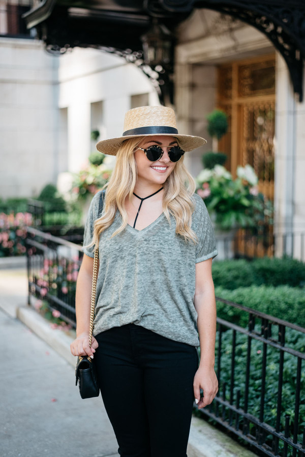 Bows & Sequins styling a casual outfit for fall. Janessa Leone Hat, Oversized Tee, Strappy Bralette, Frame Jeans, Illesteva Sunglasses, Gucci Bag with Chain Strap