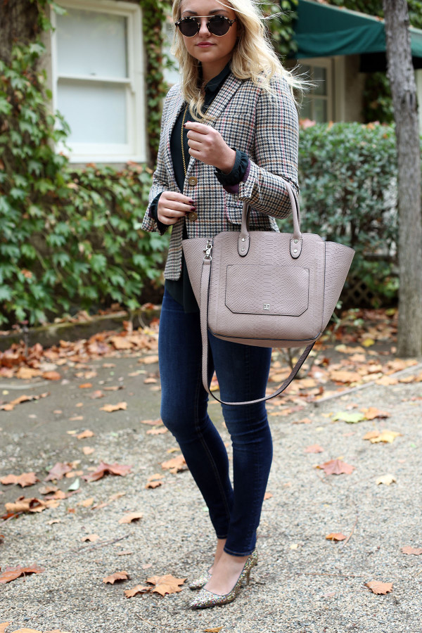Fashion blogger Bows & Sequins styling a plaid blazer, skinny jeans, and glitter pumps for the office.