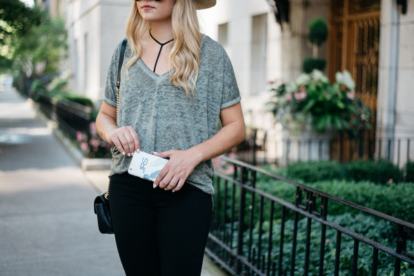 Bows & Sequins styling a casual outfit for fall. Janessa Leone Hat, Oversized Tee, Strappy Bralette, Frame Jeans