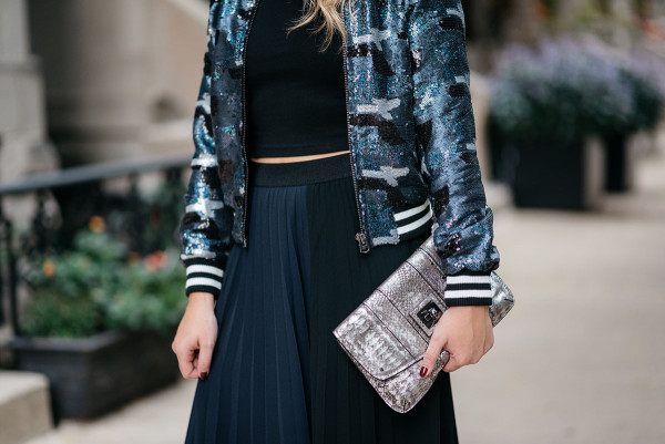 Bows & Sequins styling a sequin bomber jacket and pleated colorblocked midi skirt.