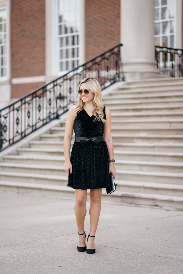 Bows & Sequins styling a black velvet dress for the holidays.
