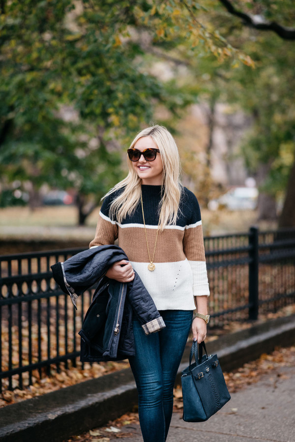 Chicago blogger Jessica Sturdy of Bows & Sequins wearing a navy, tan, and white striped colorblocked sweater.
