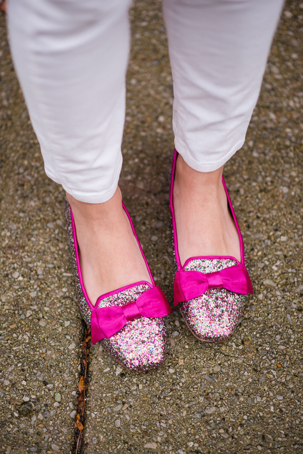 Bows & Sequins wearing a pair of Kate Spade glittery bow flats.
