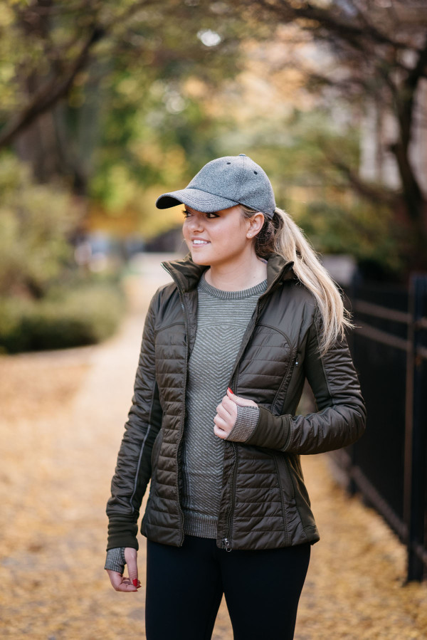 Bows & Sequins wearing a lululemon Baller Hat, First Mile Jacket, and lululemon crewneck tee in Lincoln Park in Chicago.