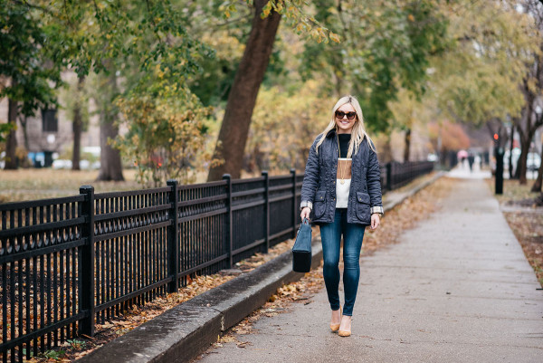 Bows & Sequins wearing a quilted Barbour Jacket and a striped sweater in Chicago's Gold Coast.