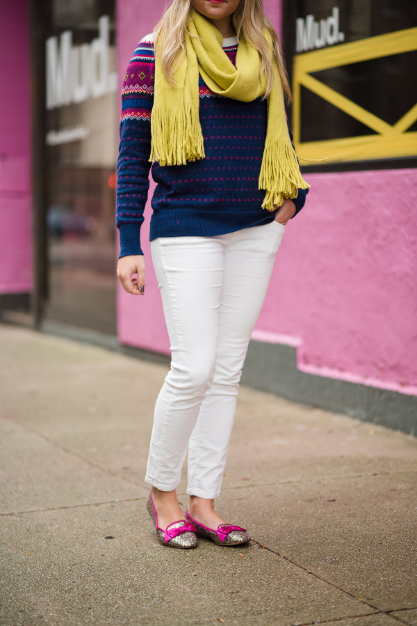 Bows & Sequins styling a pair of winter white corduroy pants with a fair isle sweater, Kate Spade glitter flats, and bright scarf.