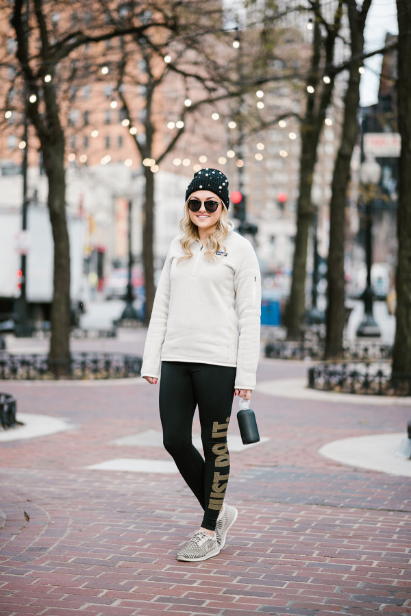 Bows & Sequins wearing a pearl beanie, Karen Walker sunglasses, a Patagonia pullover, Nike Just Do It Leggings, Nike Roche Flyknit Sneakers, and a BKR Water Bottle in Chicago's Gold Coast.