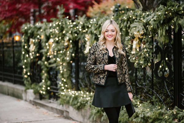 Bows & Sequins wearing a black and gold holiday outfit from Old Navy!
