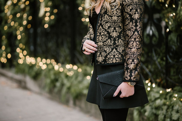 Bows & Sequins styling a black and gold jacket for a holiday party.