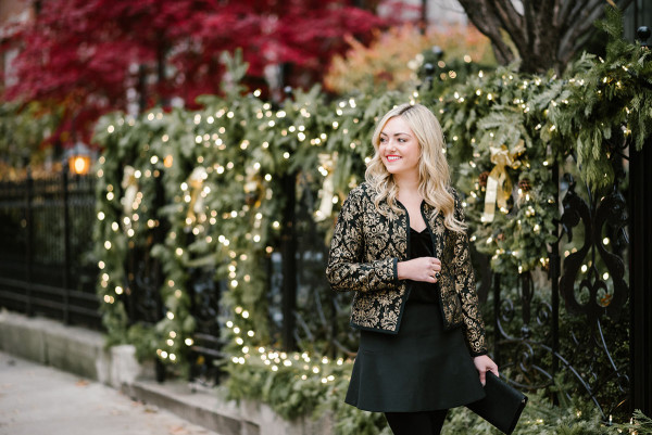Bows & Sequins styling a black and gold embroidered jacket.