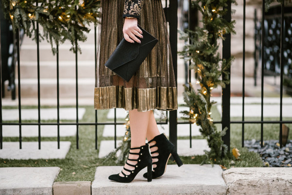Bows & Sequins styling black and gold military-inspired pumps.