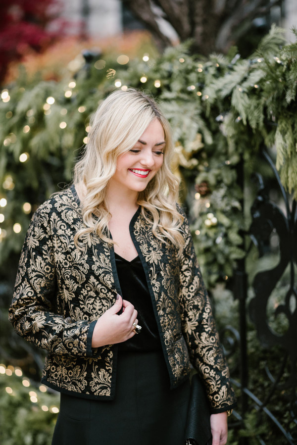 Bows & Sequins wearing a black and gold jacket with a velvet cami.