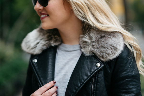 Bows & Sequins wearing a leather moto jacket with a removable faux fur collar.