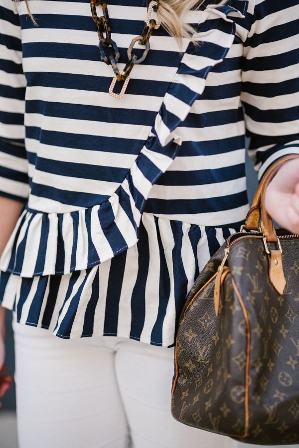 Bows & Sequins wearing a J.Crew ruffled striped shirt with a Louis Vuitton Speedy bag.
