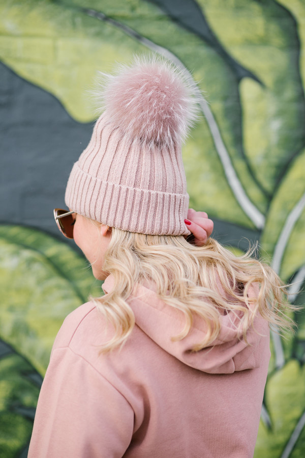 Bows & Sequins wearing a blush pink pom pom beanie.