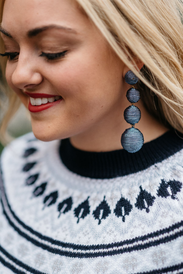 Bows & Sequins wearing the Must-Have Statement Earring of the Season: Bon-Bon Earrings! The perfect accessory for everything from fair isle sweaters to holiday party dresses.